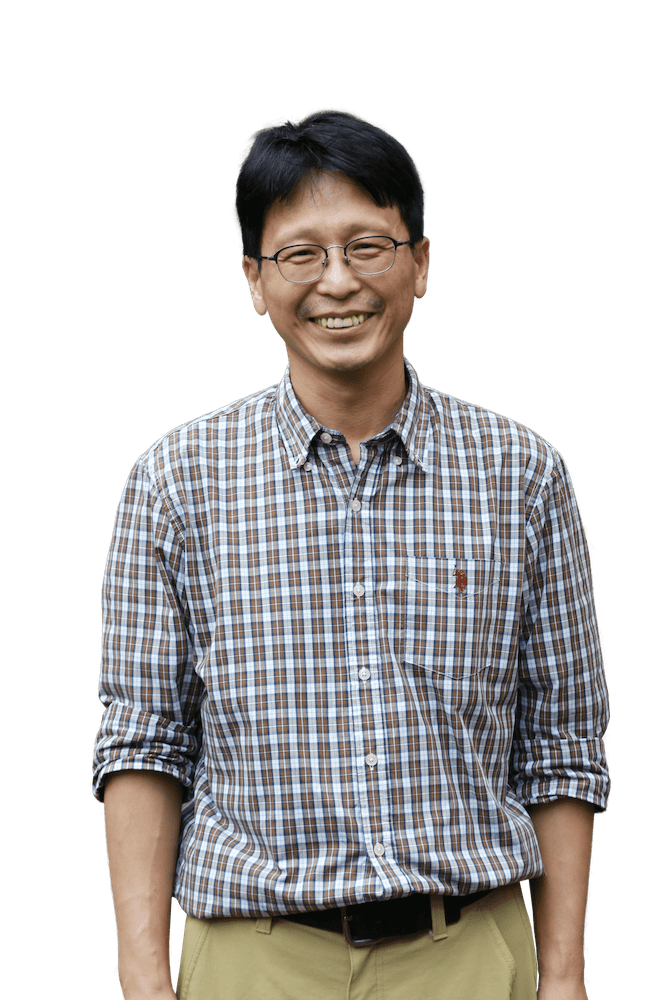 headshot of Jin Cho, with glasses and gray checkered shirt
