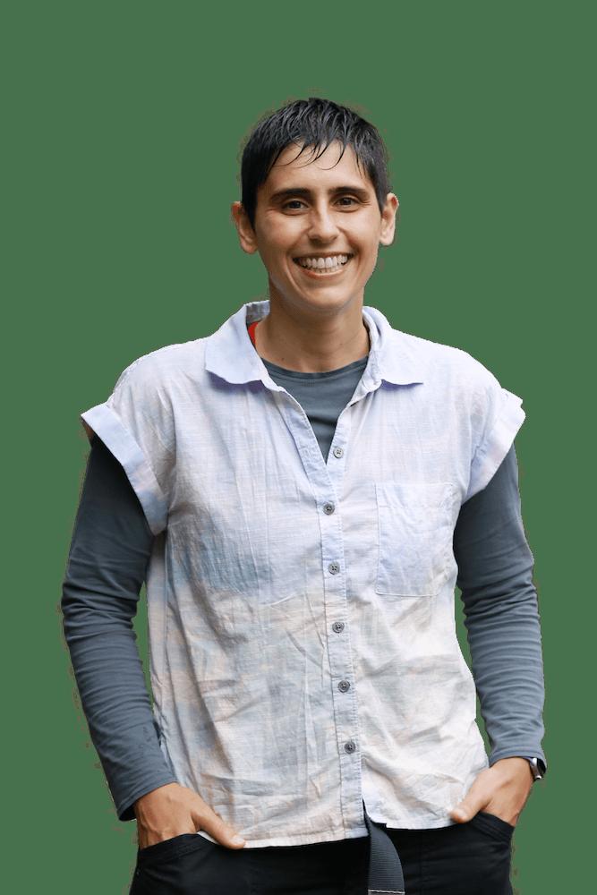 headshot of Lorena Pantano, wearing a white collared shirt with blue sleeves