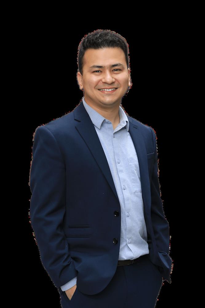 headshot of Nilesh Amatya, wearing a blue business suit.